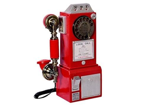 Teléfono antiguo de pared rojo